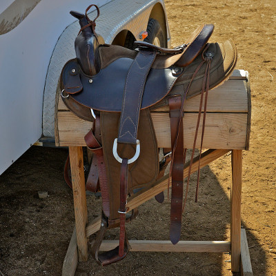 Western saddles have a multitude of straps and strings and metal rings that makes it easy to carry canteens and other items.  Photo by Charles Hood.